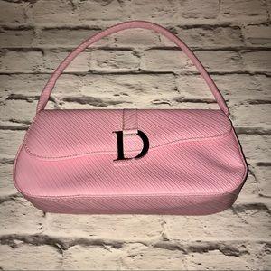 Pink saddle purse
